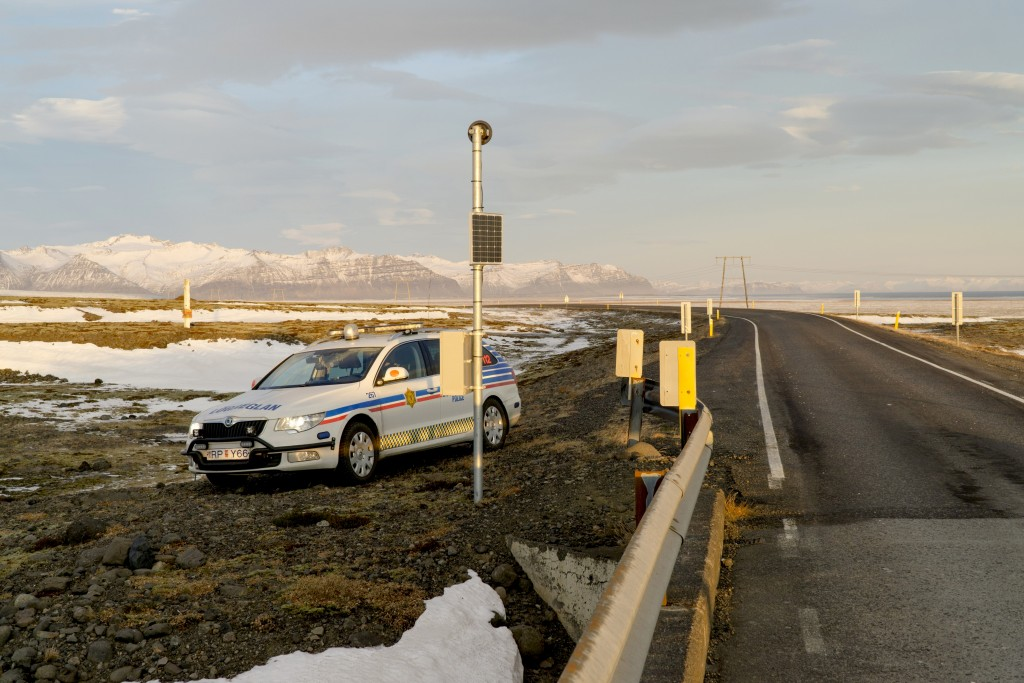 A police car is parked by the side of the road at the foot of Oraefajokull volcano in Iceland, Thursday, Nov. 30, 2017. The Oraefajokull volcano, dorm