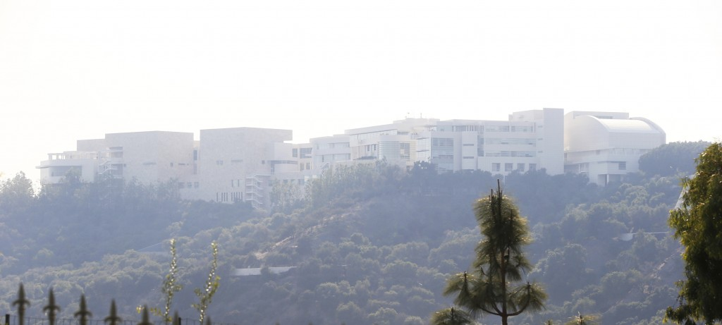 The Getty Center lies shrouded in smoke as seen from the Bel Air district of Los Angeles after the Skirball wildfire swept through Wednesday, Dec. 6,