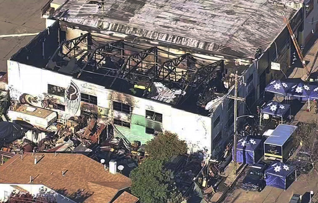 FILE- This Dec. 3, 2016, file image from video provided by KGO-TV shows the Ghost Ship Warehouse after a fire swept through the building in Oakland, C