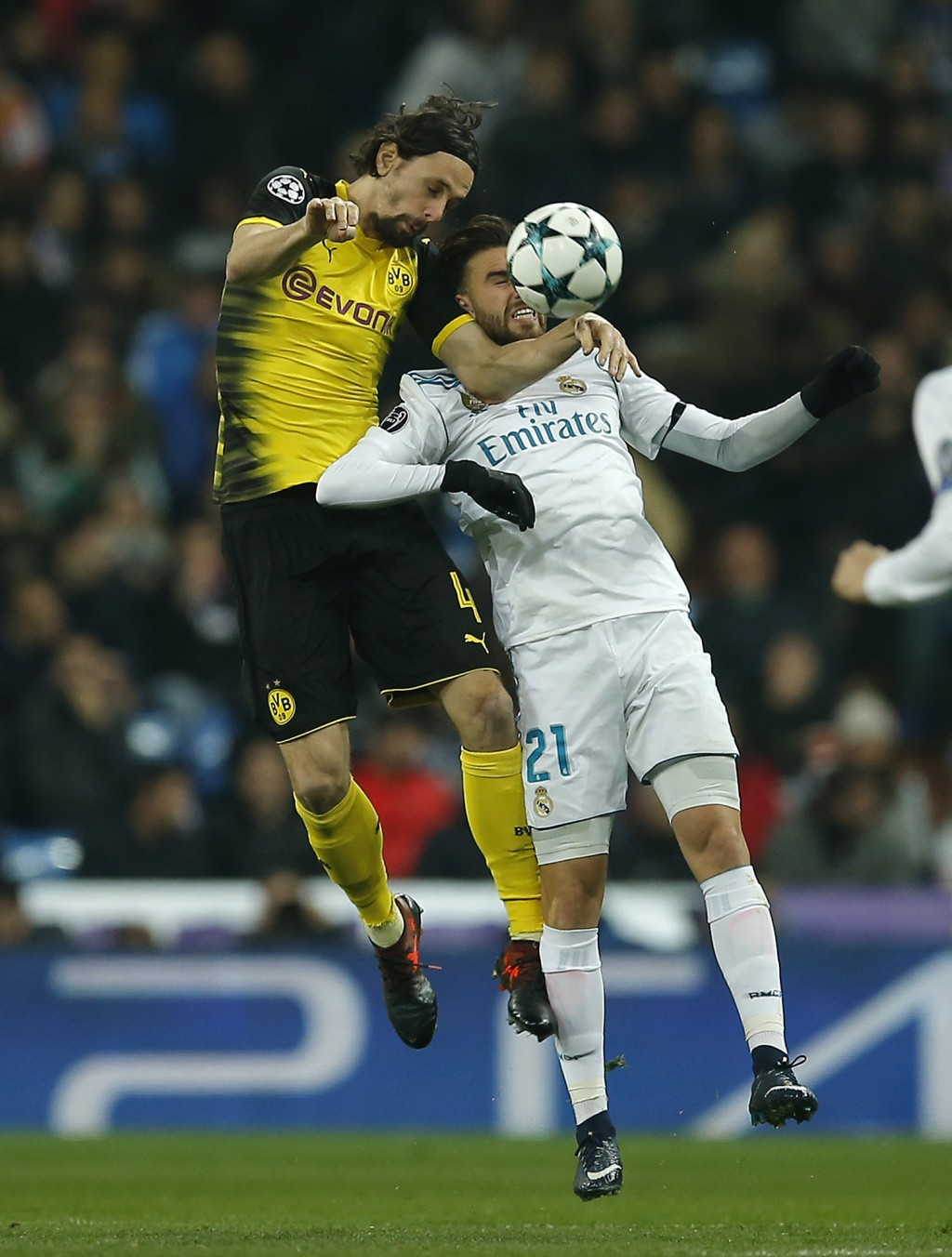 Dortmund's Neven Subotic, left, and Real Madrid's Borja Mayoral challenge for the ball during the Champions League Group H soccer match between Real M