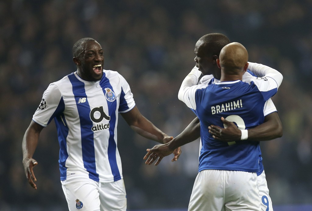 Porto's Yacine Brahimi, right, celebrates with Vincent Aboubakar, 2nd right, and Moussa Marega after scoring his side's third goal during the Champion