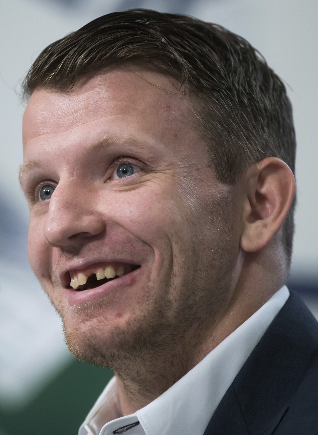 Derek Dorsett, who had to retire from playing professional hockey with the Vancouver Canucks recently due to medical reasons, smiles while speaking du