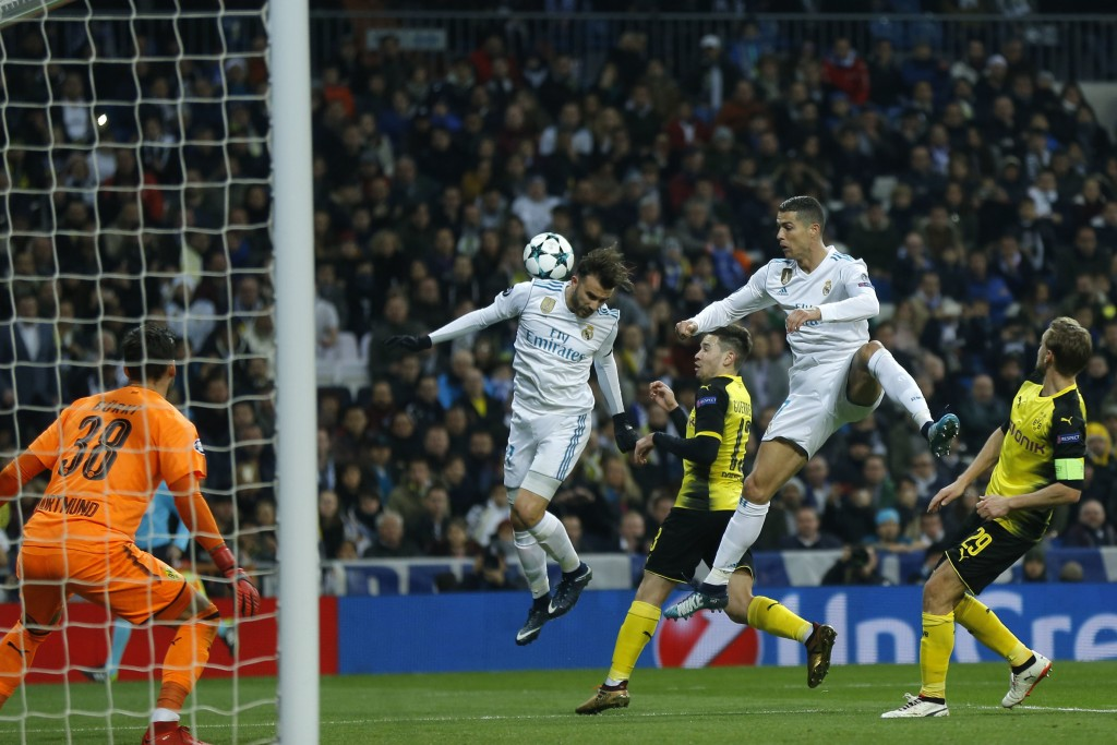 Real Madrid's Borja Mayoral, left, and Real Madrid's Cristiano Ronaldo go for a header during the Champions League Group H soccer match between Real M