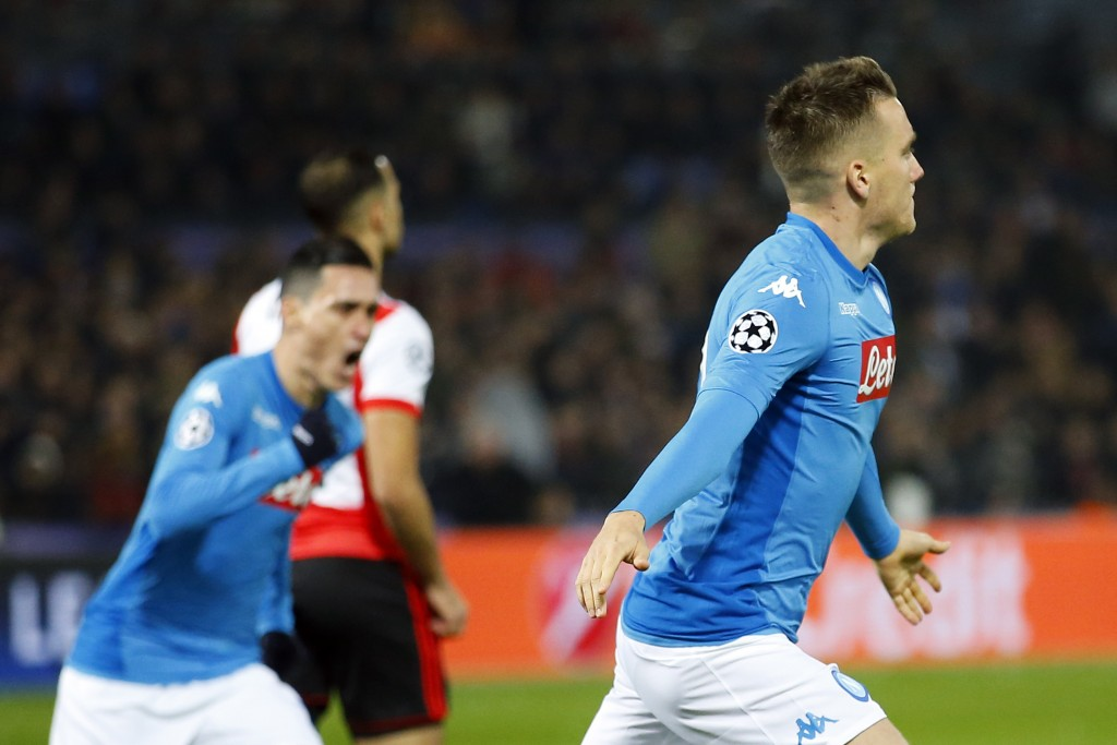 Napoli's Piotr Zielinski, right, celebrates scoring the opening goal during a Champions League Group F soccer match between Feyenoord and Napoli at th