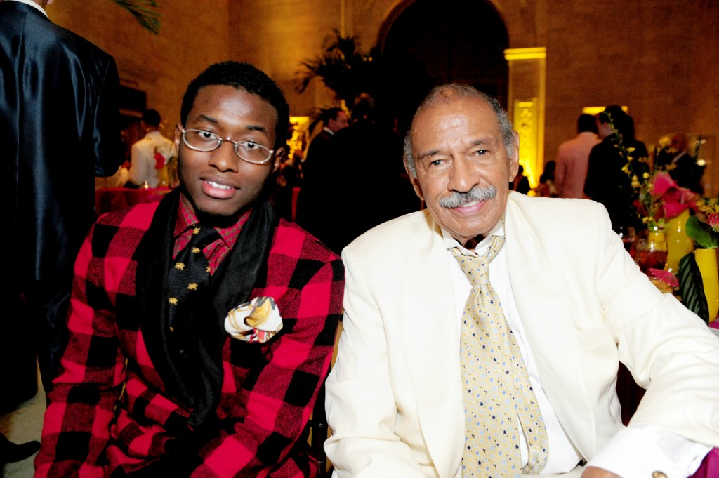 In this July 16, 2011 photo, John Conyers, III poses with his father Rep. John Conyers, D-Mich., in Detroit. John Conyers' resignation from the U.S. H