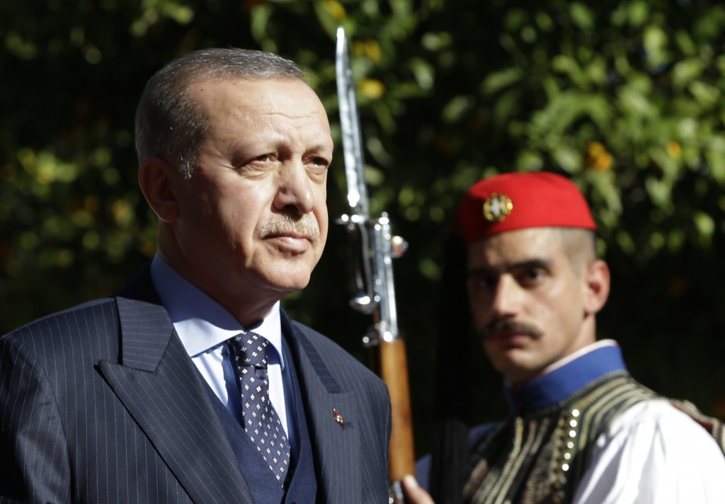 Turkey's President Recep Tayyip Erdogan reviews the Presidential Guard with Greece's President Prokopis Pavlopoulos, during the welcome ceremony in At