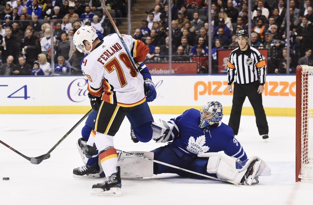 Toronto Maple Leafs goalie Frederik Andersen (31) makes a save as Calgary Flames left wing Micheal Ferland (79) looks for a rebound during the third p