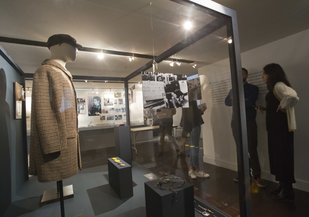 In this photo taken on Tuesday, Dec. 5, 2017, the coat and the hat of French Nazi hunter Serge Klarsfeld are displayed, at the Shoah Memorial in Paris