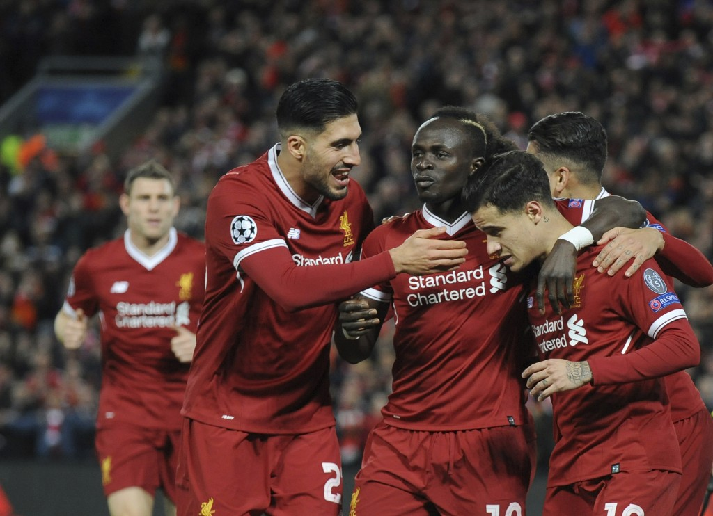 Liverpool's Philippe Coutinho, right, celebrates with his teammates after scoring his side's fifth goal during the Champions League Group E soccer mat