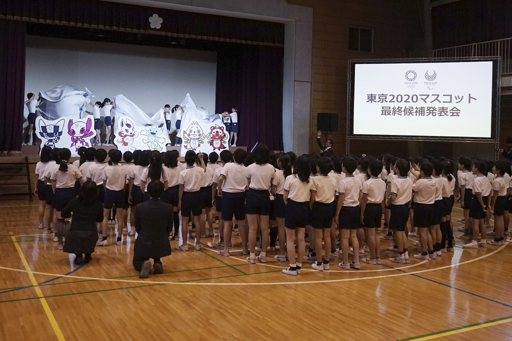 Children unveil the shortlisted three mascot design sets which each contain one mascot for the Tokyo 2020 Olympic Games and one for the Paralympic Gam