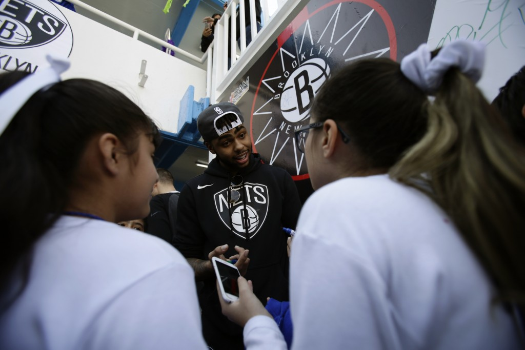 The Brooklyn Nets D'Angelo Russell signs autographs and takes selfies with students during an NBA Cares event at the Maestro Miguel A. Quintana Primar