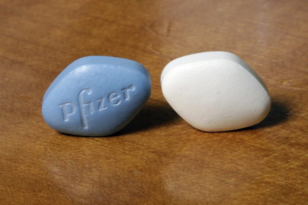 This Monday, Dec. 4, 2017 photo shows a tablet of Pfizer's Viagra, left, and the company's generic version, sildenafil citrate, at Pfizer Inc., headqu