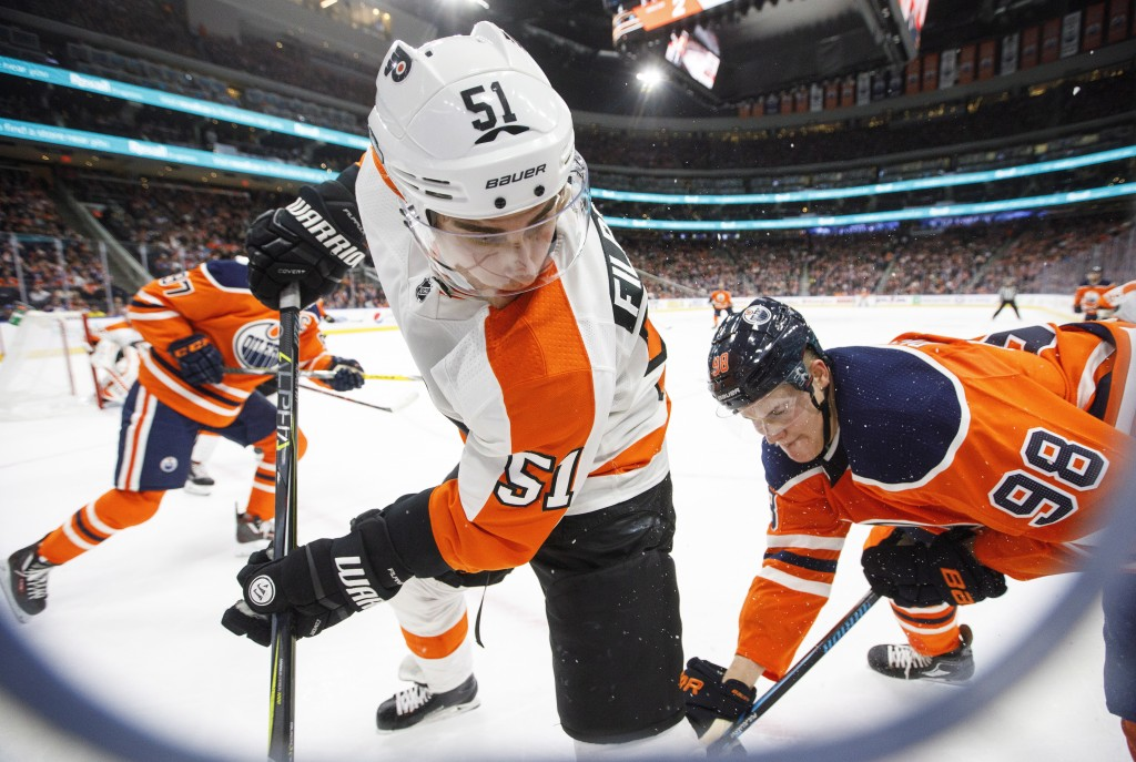Philadelphia Flyers' Valtteri Filppula (51) battles for the puck with Edmonton Oilers' Jesse Puljujarvi (98) during the second period of an NHL hockey