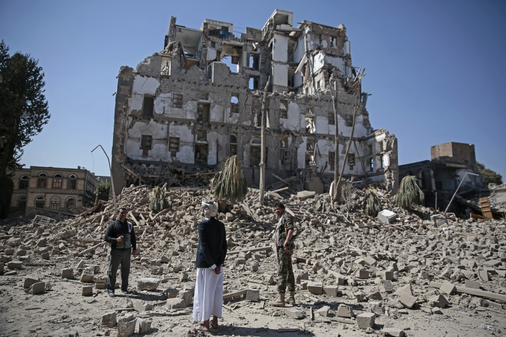 Houthi Shiite rebels inspect the rubble of the Republican Palace that was destroyed by Saudi-led airstrikes, in Sanaa, Yemen, Wednesday, Dec. 6, 2017.
