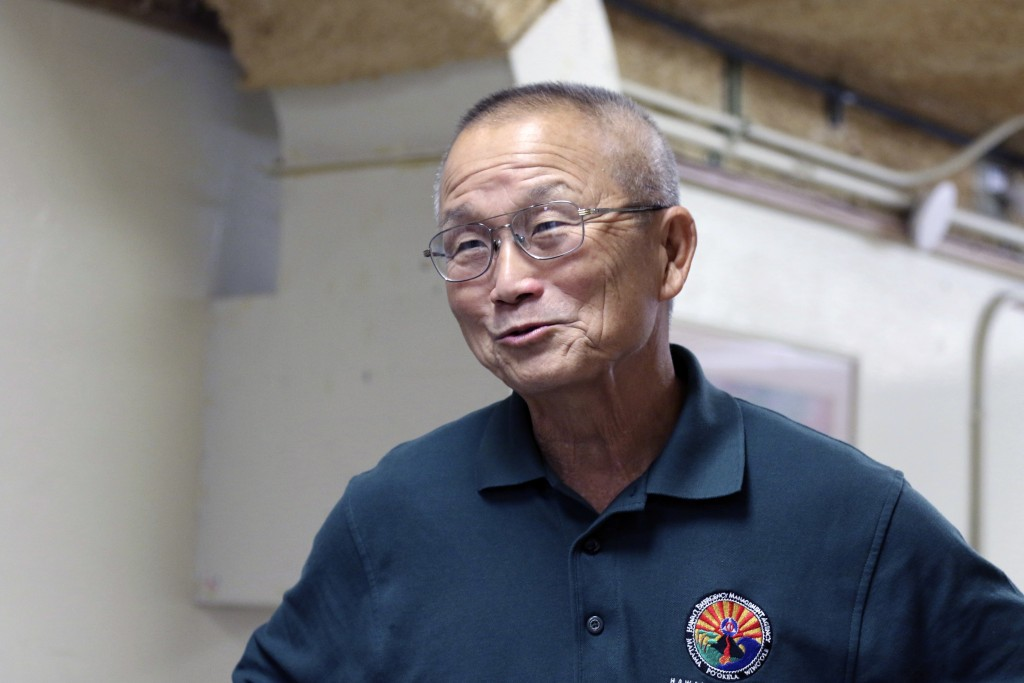 FILE- In this Dec. 1, 2017, file photo, Vern Miyagi, administrator of the Hawaii Emergency Management Agency, talks to reporters at the Hawaii Emergen