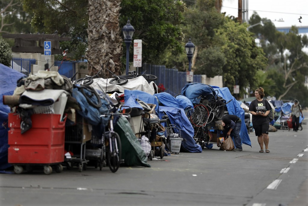 """In this Sept. 19, 2017 photo, trash from homeless encampments lines a street in San Diego. In a place that bills itself as """"America's Finest City,"""" re"""