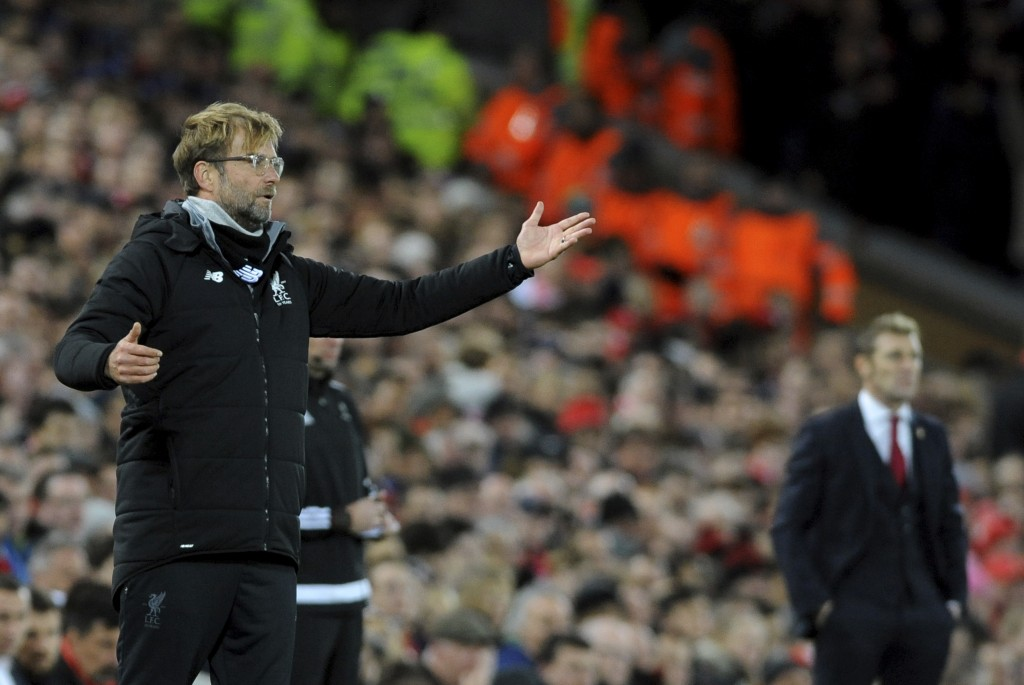 Liverpool's manager Jurgen Klopp gives directions to his players during the Champions League Group E soccer match between Liverpool and Spartak Moscow