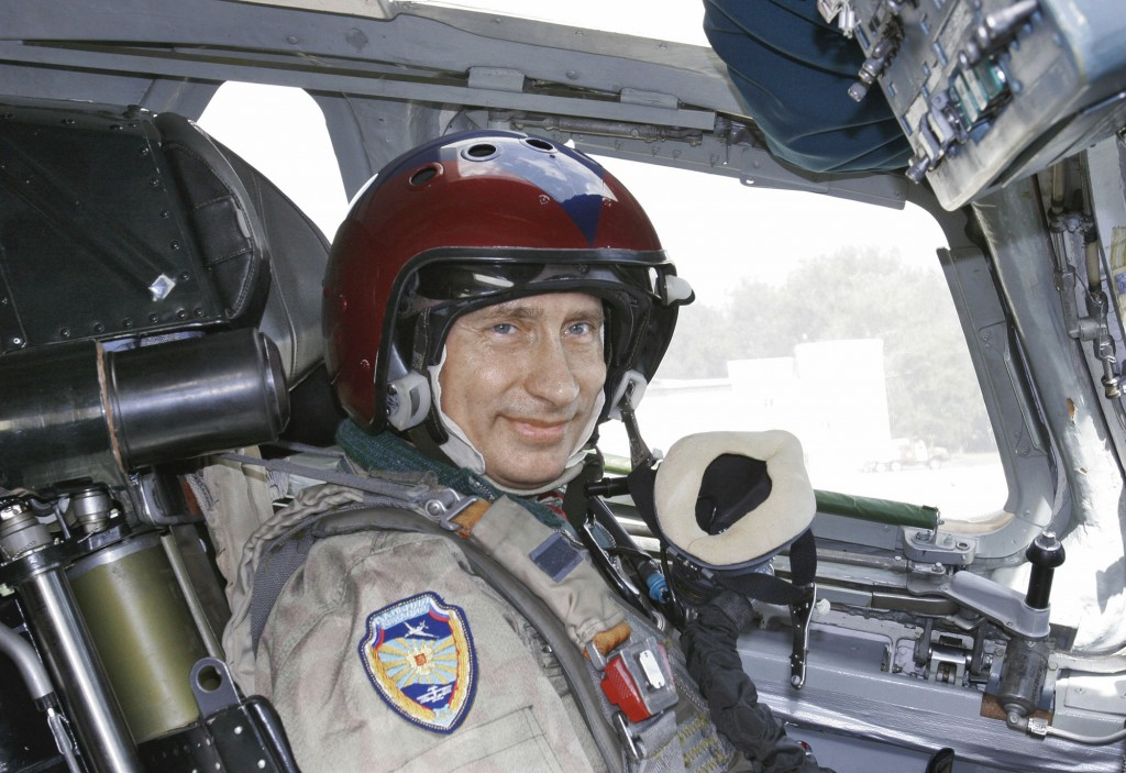 FILE - In this file photo taken on Tuesday, Aug. 16, 2005, Russian President Vladimir Putin wearing a jump suit sits in the cockpit of a supersonic st