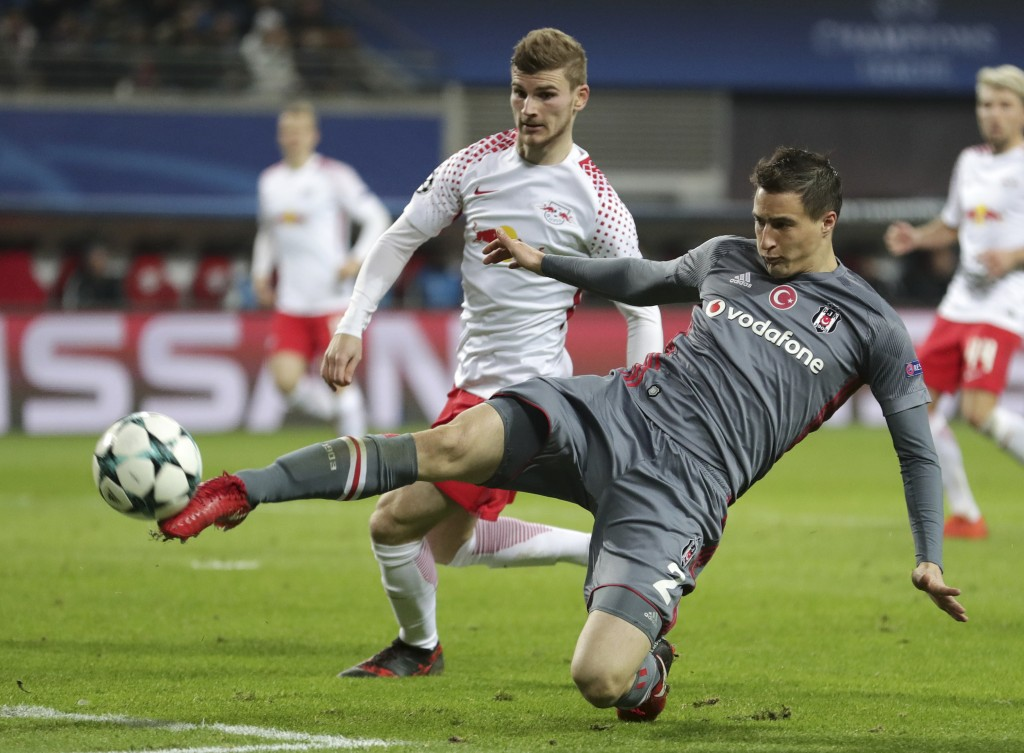 Besiktas' Matej Mitrovic, front, clears ahead of Leipzig's Timo Werner during the Champions League Group G soccer match between RB Leipzig and Besikta