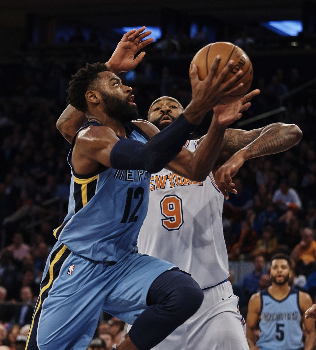 Memphis Grizzlies' Tyreke Evans (12) drives to the basket against New York Knicks' Kyle O'Quinn (9) during the first half of an NBA basketball game at