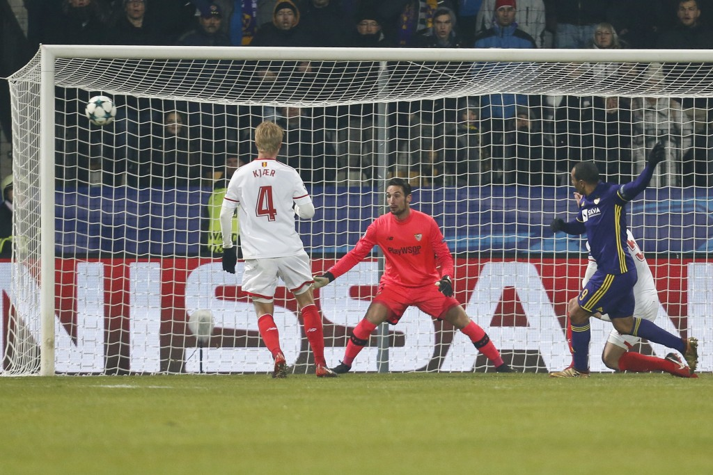 Maribor's Marcos Tavares, blue, shots over the goal during the group E Champions League soccer match between Maribor and Sevilla at the Ljudski Vrt st
