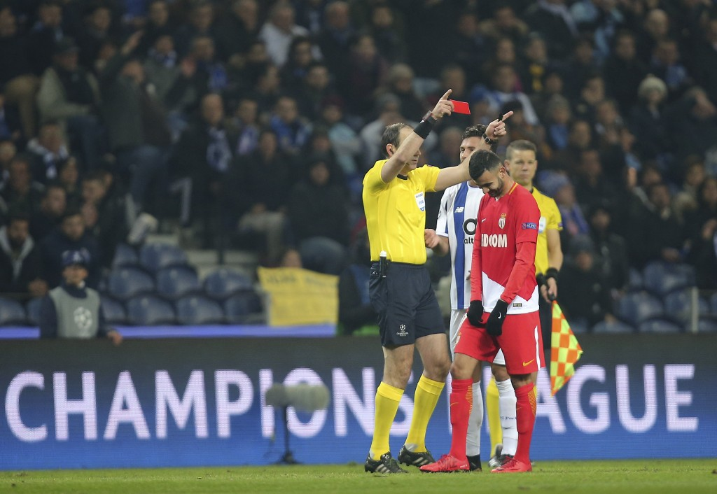 Referee Jonas Eriksson shows a red card to Monaco's Rachid Ghezzal during the Champions League group G soccer match between FC Porto and AS Monaco at
