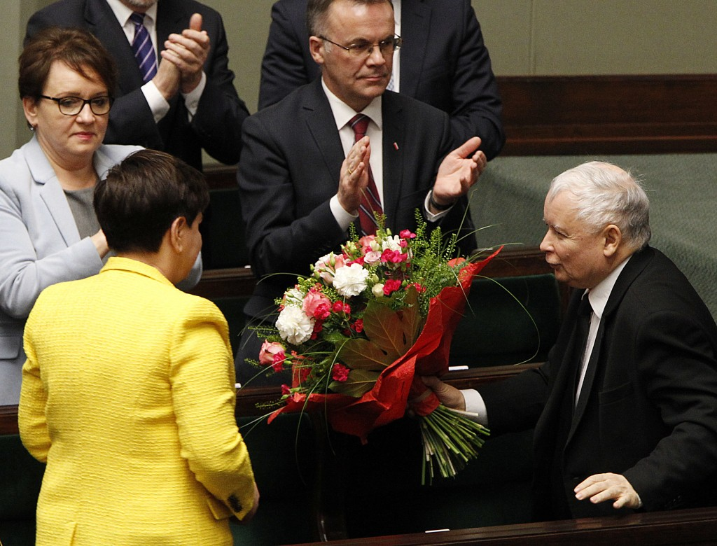 Jaroslaw Kaczynski, the powerful leader of Poland's ruling Law and Justice party congratulates Prime Minister Beata Szydlo after her government surviv