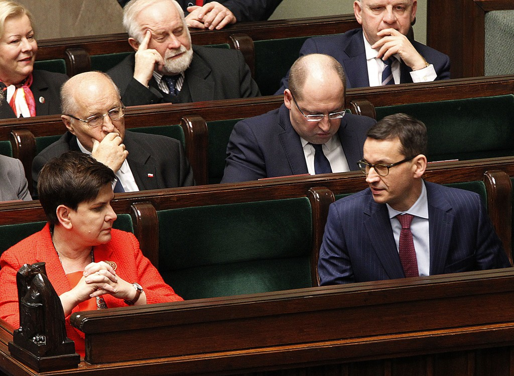 In this Dec. 5, 2017 photo Poland's Prime Minister Beata Szydlo, front left and Finance Minister Mateusz Morawiecki, front right, attend a parliament
