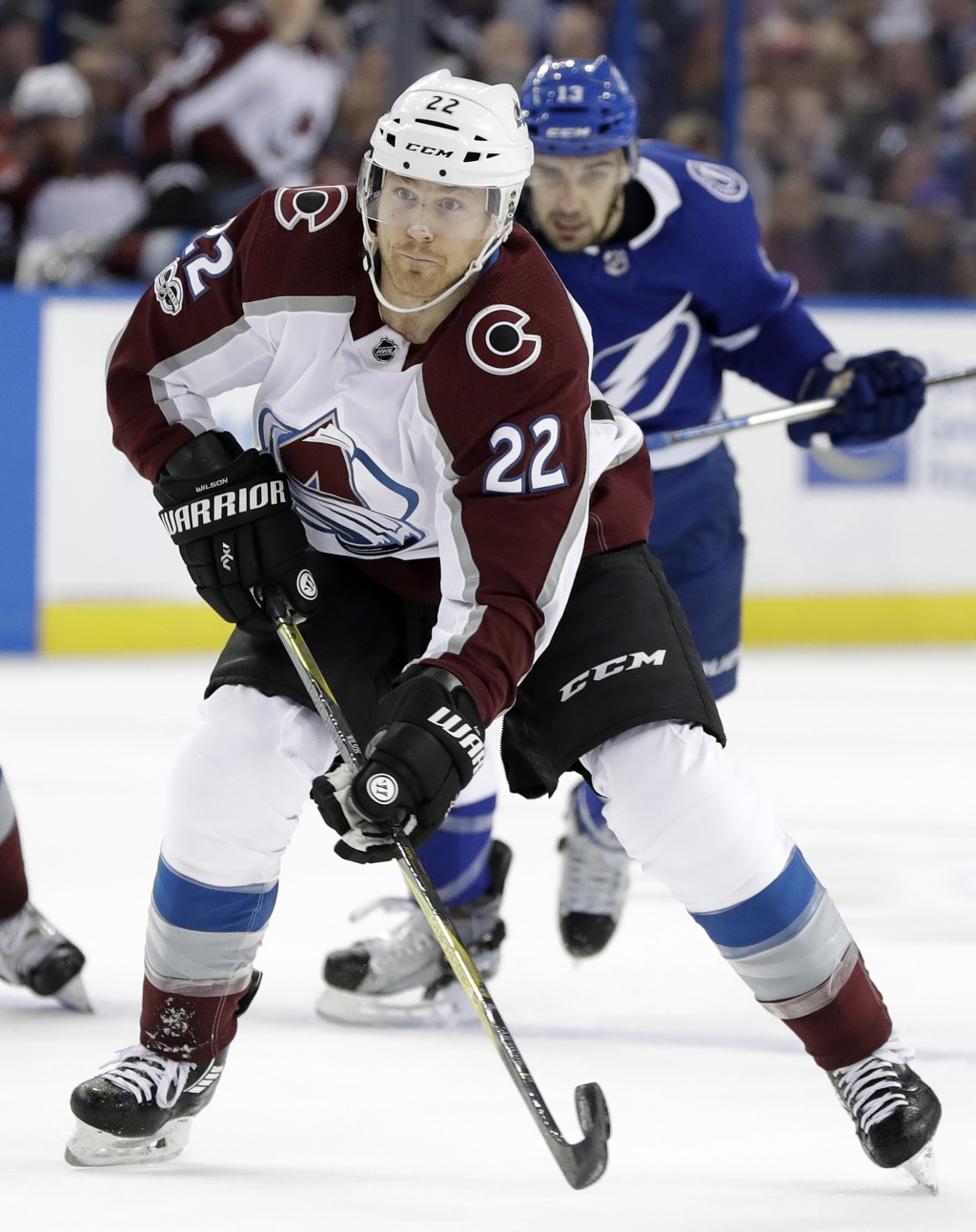 Colorado Avalanche center Colin Wilson (22) loses control of the puck after getting past Tampa Bay Lightning center Cedric Paquette (13) during the fi
