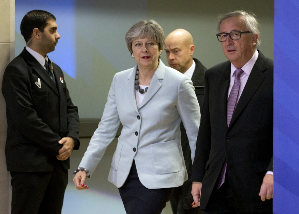 British Prime Minister Theresa May, left, walks with European Commission President Jean-Claude Juncker, right, prior to a meeting at EU headquarters i