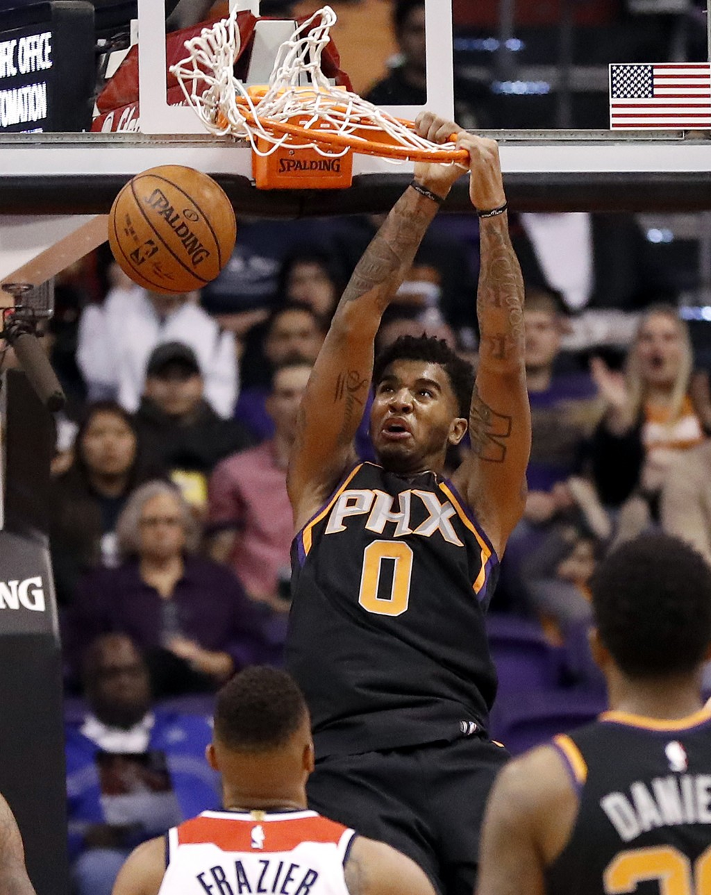 Phoenix Suns forward Marquese Chriss (0) dunks against the Washington Wizards during the first half of an NBA basketball game, Thursday, Dec. 7, 2017,