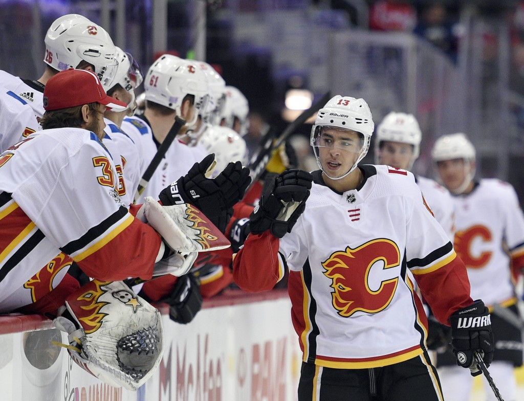 FILE - In this Nov. 20, 2017, file photo ,Calgary Flames left wing Johnny Gaudreau (13) celebrates his goal during the first period of an NHL hockey g