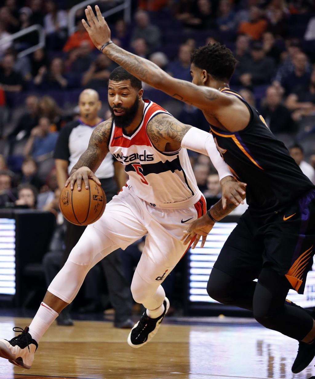 Washington Wizards forward Markieff Morris (5) drives against Phoenix Suns forward Marquese Chriss during the first half of an NBA basketball game, Th