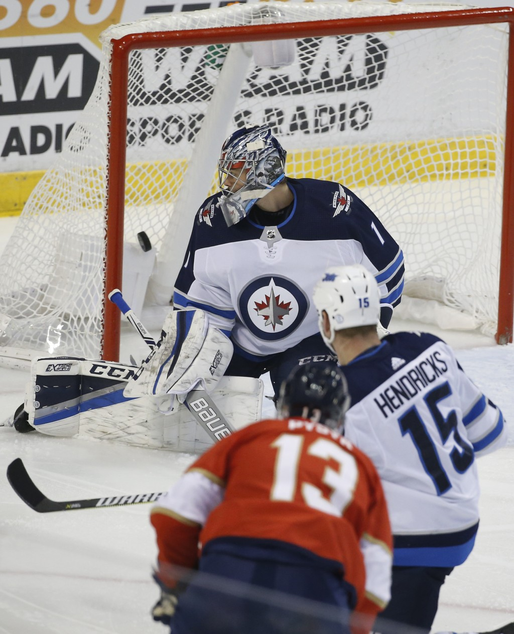 Florida Panthers defenseman Mark Pysyk (13) scores a goal against Winnipeg Jets goalie Eric Comrie (1) during the first period of an NHL hockey game T