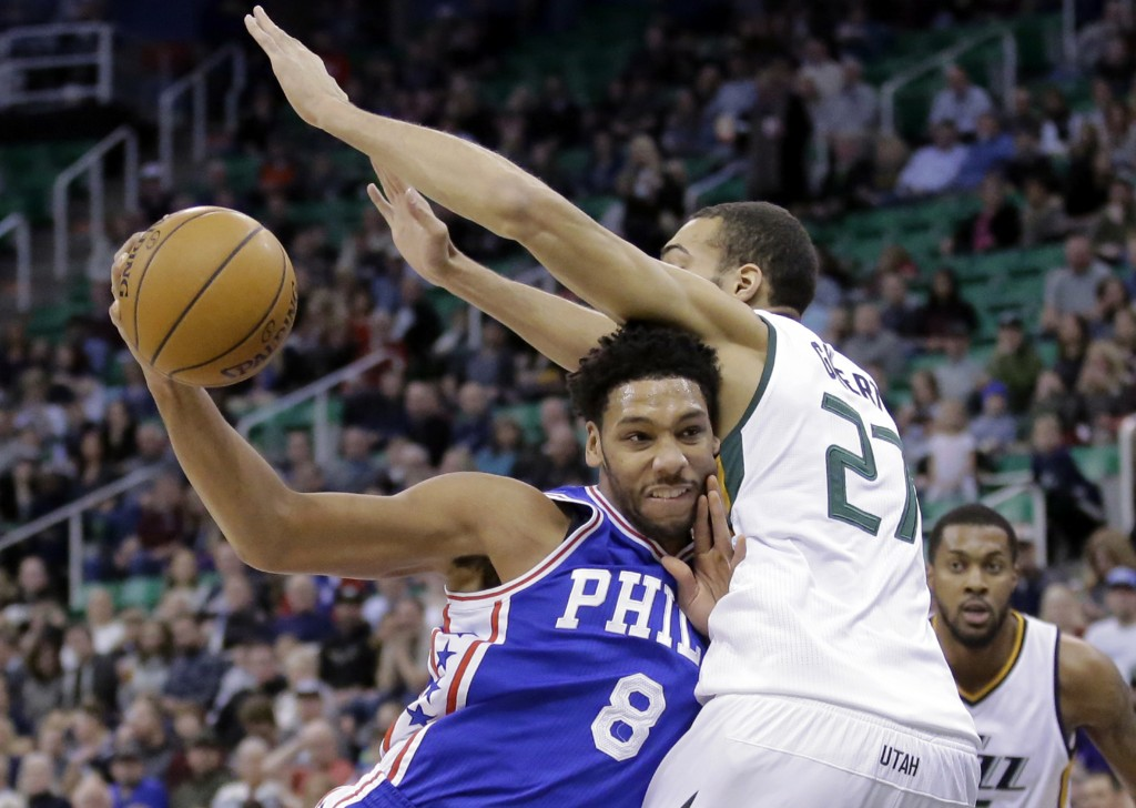 FILE - In this Dec. 29, 2016, file photo, Philadelphia 76ers center Jahlil Okafor (8) drives to the basket as Utah Jazz center Rudy Gobert (27) defend