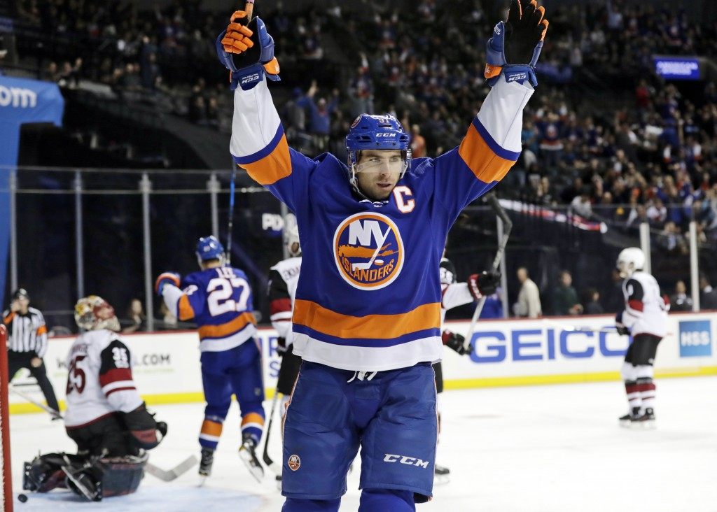 FILE - In this Oct. 24, 2017, file photo, New York Islanders' John Tavares (91) celebrates after scoring a goal against Arizona Coyotes goalie Louis D