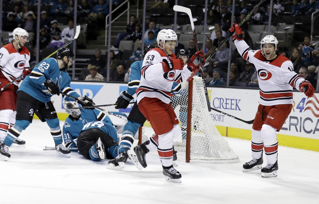 Carolina Hurricanes left wing Jeff Skinner, center, celebrates with teammate Justin Williams, right, after Skinner's goal against the San Jose Sharks