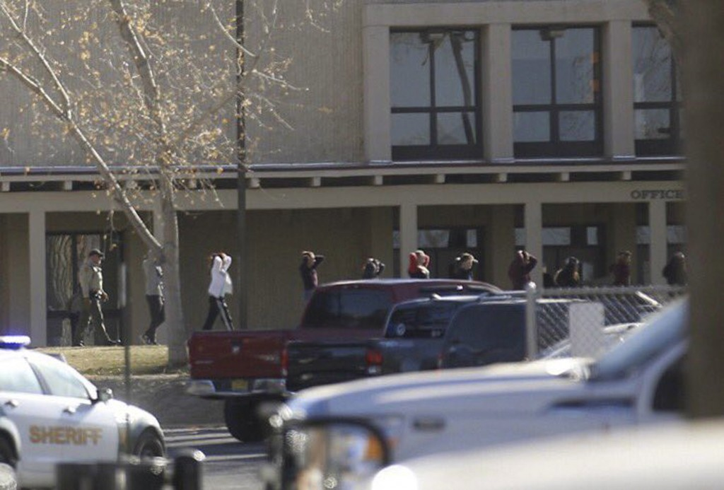 Students are led out of Aztec High School after a shooting Thursday, Dec. 7, 2017, in Aztec, N.M. The school is in the Four Corners region and is near