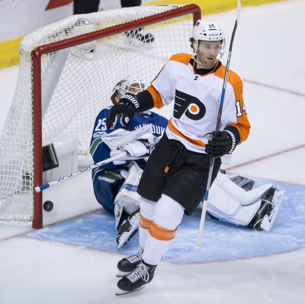 Philadelphia Flyers center Sean Couturier (14) celebrates his goal against Vancouver Canucks goalie Jacob Markstrom (25) during the second period of a