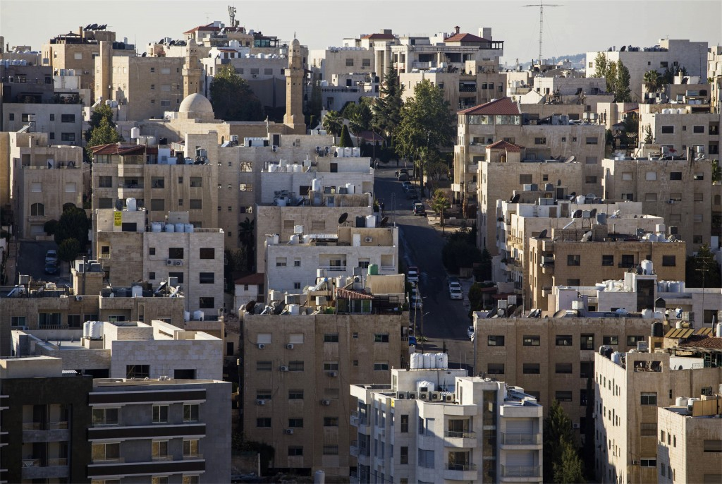 This Nov. 30, 2017 photo, shows densely built apartment buildings and steep hills that are common in Amman, Jordan. A shiny new high-tech utopian city