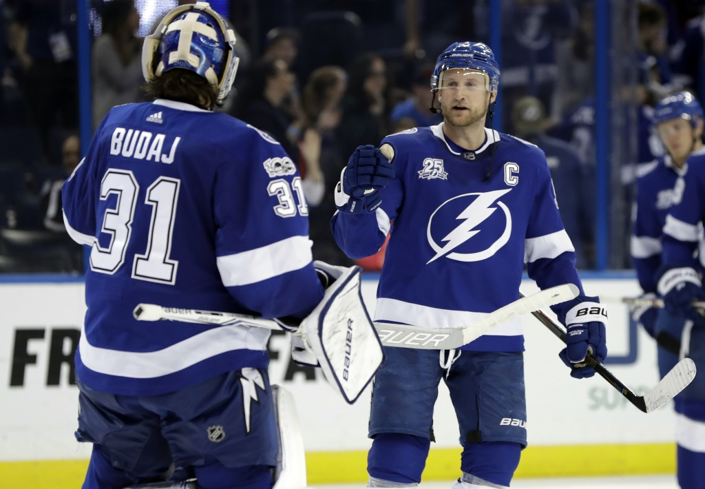 Tampa Bay Lightning center Steven Stamkos (91) celebrates with goalie Peter Budaj (31) after the Lightning defeated the Colorado Avalanche 5-2 during