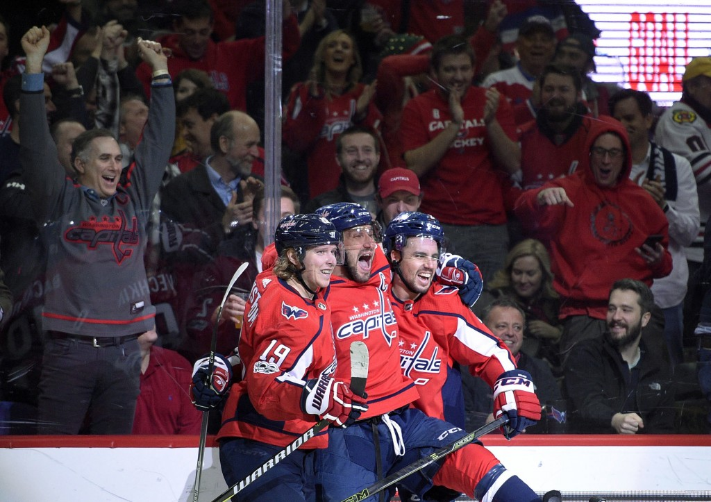 FILE - In this Wednesday, Dec. 6, 2017, file photo, Washington Capitals left wing Alex Ovechkin, center, of Russia, celebrates his goal with center Ni