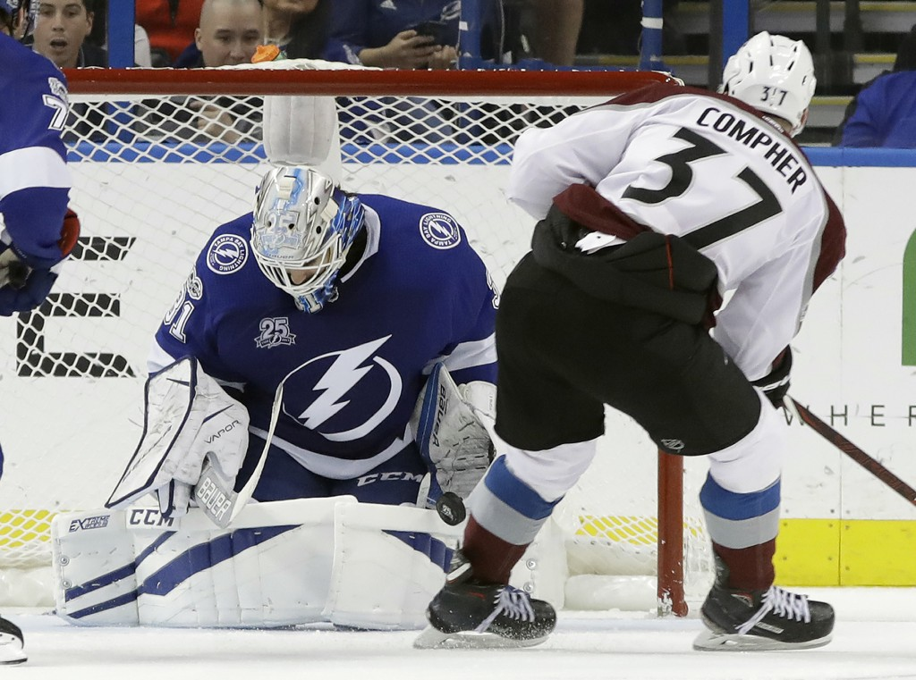 Tampa Bay Lightning goalie Peter Budaj (31) makes a save on a shot by Colorado Avalanche left wing J.T. Compher (37) during the second period of an NH