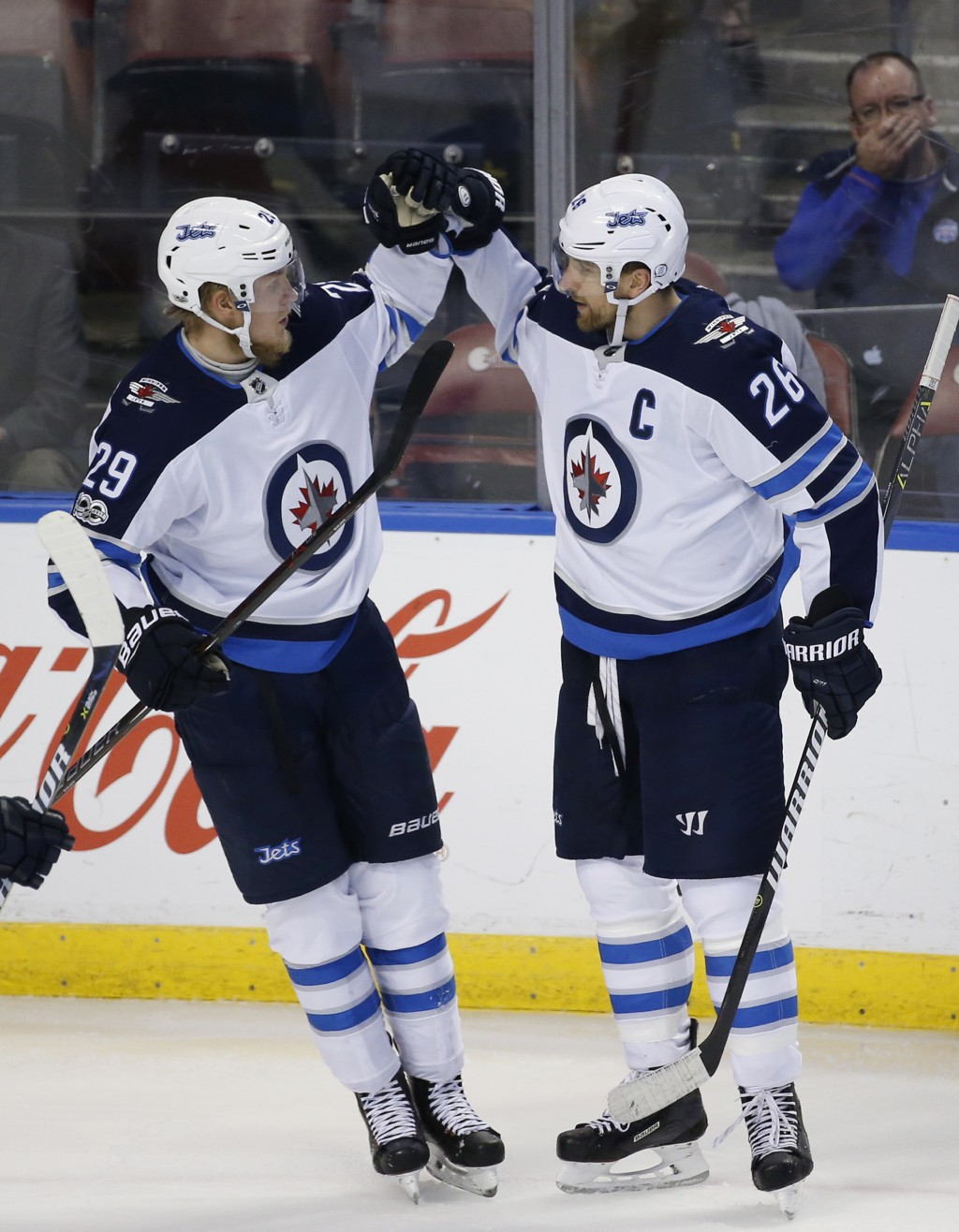 Winnipeg Jets right wing Patrik Laine (29) congratulates right wing Blake Wheeler (26) after Wheeler scored during the second period of an NHL hockey