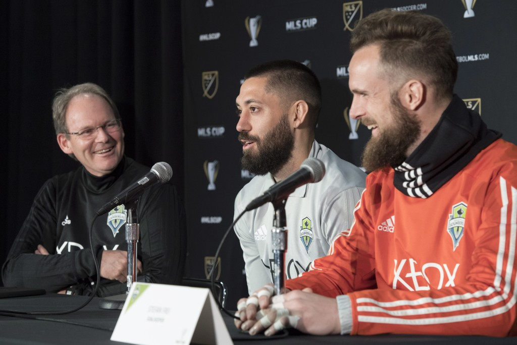 From left, Seattle Sounder head coach Brian Schmetzer, forward Clint Dempsey and goaltender Stefan Frei share a laugh during a news conference in Toro