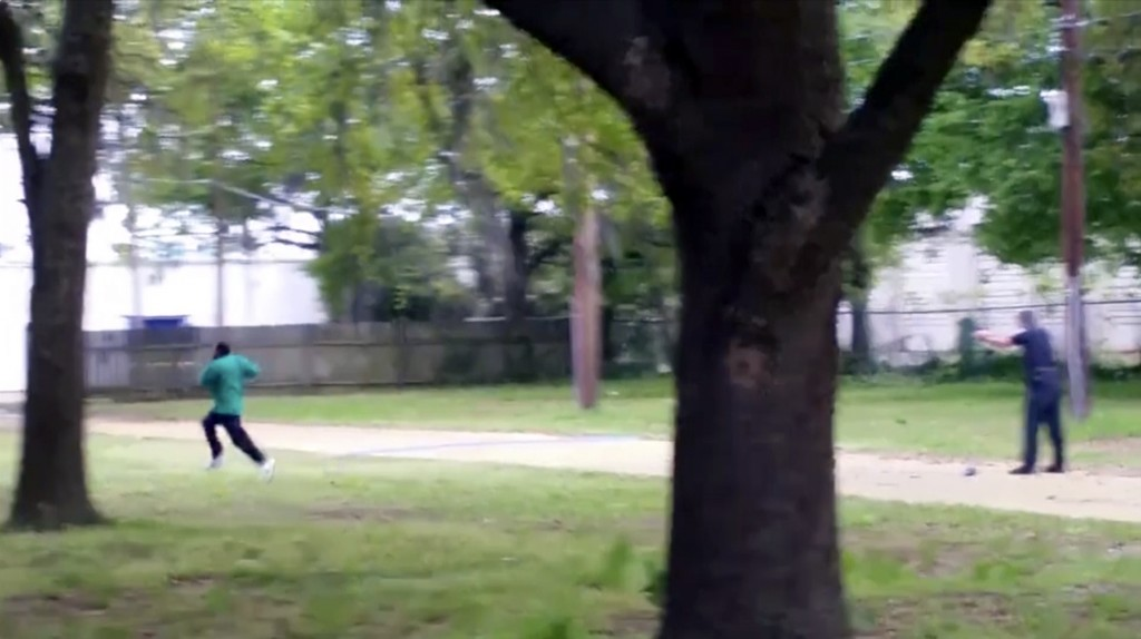 FILE - In this April 4, 2015 image from video, Walter Scott, left, is shot by police officer Michael Thomas Slager in Charleston, S.C. Slager, a white