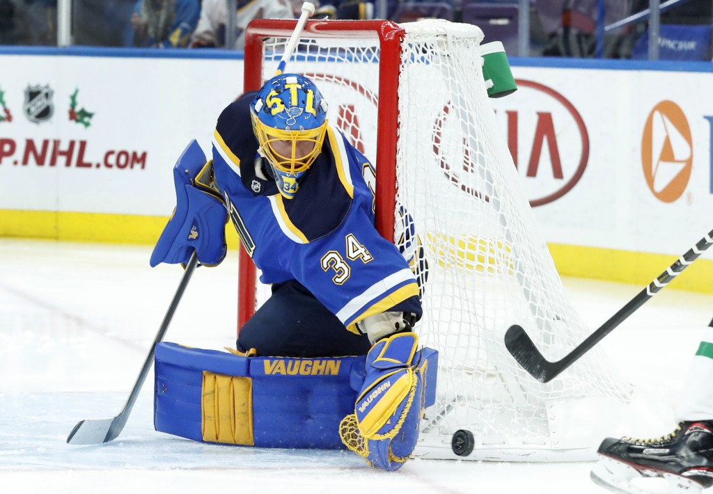 St. Louis Blues goalie Jake Allen watches the puck slide past during the first period of an NHL hockey game against the Dallas Stars, Thursday, Dec. 7