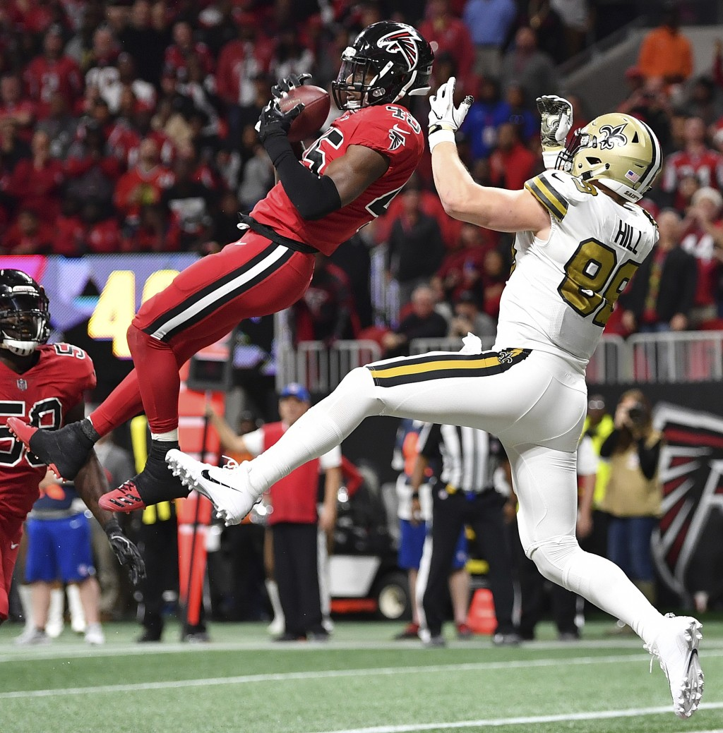 Atlanta Falcons middle linebacker Deion Jones (45) intercepts a ball in the end zone ahead of New Orleans Saints tight end Josh Hill (89) during the s