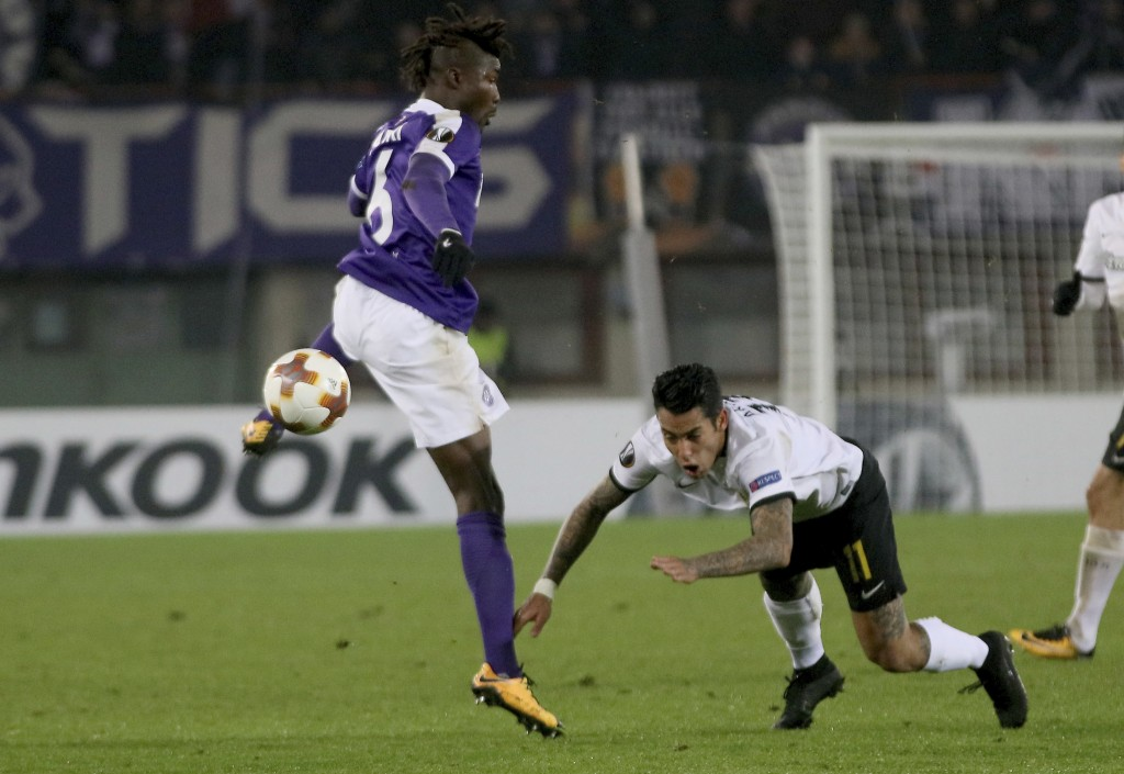 Vienna's​ Abdul Kadiri Mohammed and AEK Athens Sergio Araujo, from left, challenge for the ball during the Europa League group D soccer match between