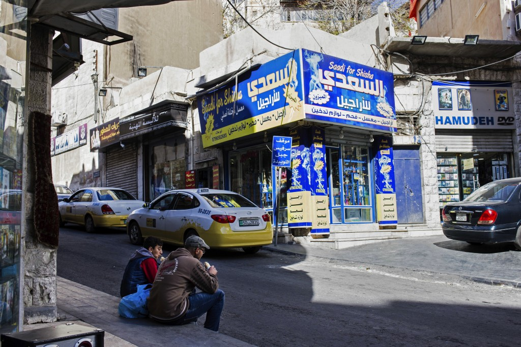 In this Saturday, Dec. 2, 2017 photo, city buses drive toward downtown Amman, Jordan. A shiny new high-tech utopian city is planned to rise from Jorda